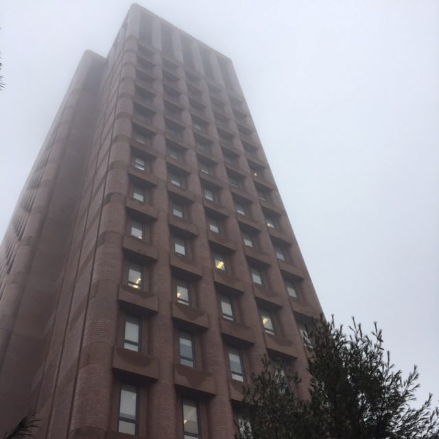 Looking up at Yale's Kline Biology Tower in thick fog